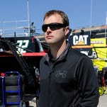 Travis Kvapil's Sprint Cup car was stolen early Friday, forcing him to withdraw from this weekend's race in Atlanta. Kvapil walks through the garage at Atlanta Motor Speedway Friday.