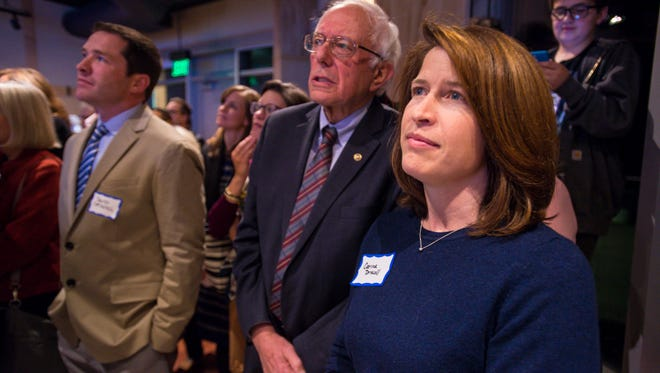Carina Driscoll and her stepfather, Vermont Sen. Bernie Sanders, are pictured at a Vermont Democratic Party event in Burlington on Nov. 9. Driscoll is running, as an independent, for mayor of Burlington, an office once held by Sanders.