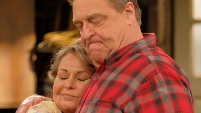 Roseanne (Roseanne Barr) and Dan (John Goodman) share a hug on ABC's 'Roseanne.'
