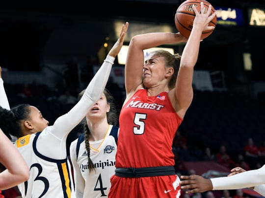 Marist College's Lovisa Henninsdottir takes a shot in front of Quinnipiac defenders on March 5 in Albany.