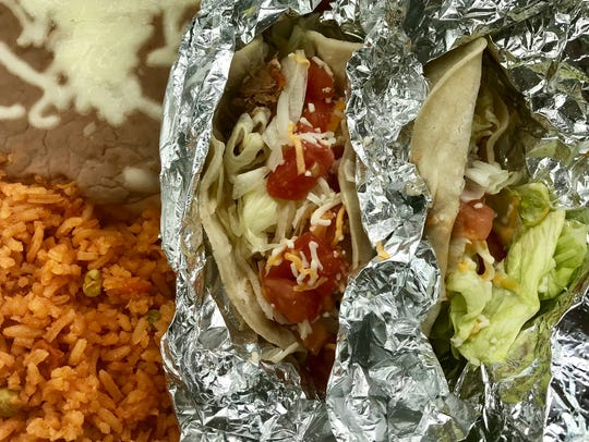 At lunch, El Toro offers two tacos with rice and beans