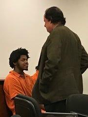 Sohjah Powell-Warner speaks with his attorney Jack Venturi