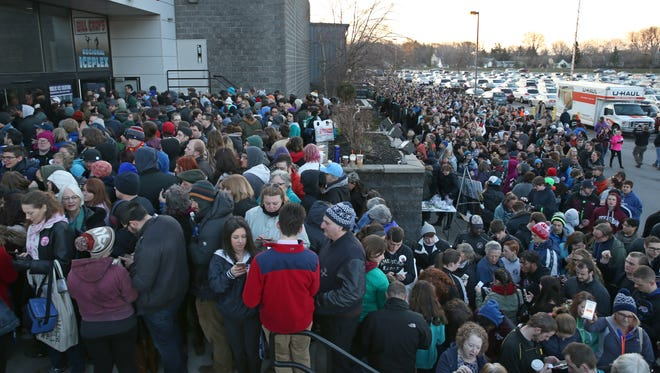 Thousands of Bernie Sanders supporters surround the Bill Gray's Regional IcePlex on the campus of Monroe Community College in Brighton as they wait to gain entry to his rally.