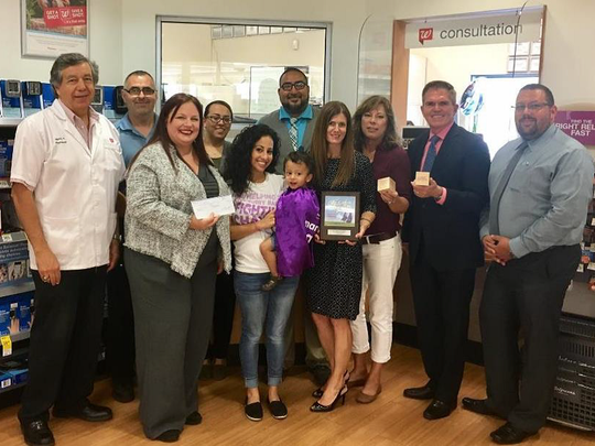 Walgreens drugstore representatives on Aug. 14 presented a check for $40,123 to the March of Dimes' Las Cruces/El Paso chapter. From left to right: Manny Hernandez, of Walgreens; Alex Rodriguez, Sarah Milford, Jackie Palomino, Brittany and Benjamin Goss, March of Dimes ambassadors; Jorge Saucedo, Jennifer Torres, March of Dimes staff; Sylvia Wood, of Walgreens; Troy Wyatt, March of Dimes chapter board chairman; and Brett Johnson, of Walgreens.