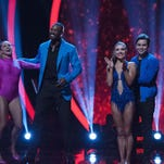 (Left) Lindsay Arnold and Calvin Johnson react to being declared safe on Sept. 20 'Dancing With The Stars' show.