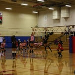 Teea Simon diverts a tip to get past T-Bird's middle blocker.
