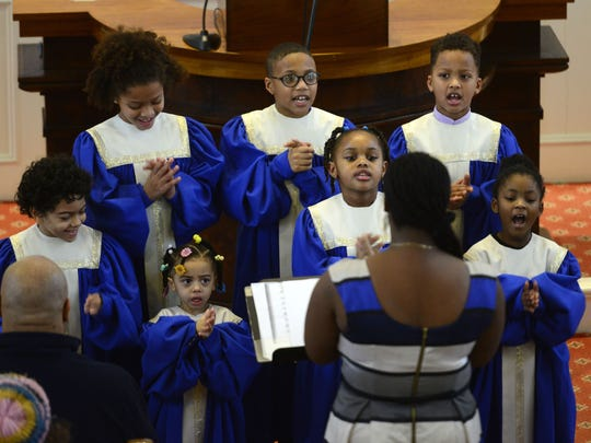 The New Alpha Missionary Children's Choir of Burlington performs at the First Unitarian Universalist Society Church in Burlington on Sunday during an annual Martin Luther King Jr. Day remembrance.