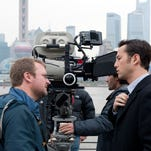"Rian Johnson chats with Joseph Gordon-Levitt between scenes on the set of ""Looper"" in 2011."