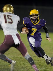 Hagerstown's Owen Golliher runs the ball against Indianapolis