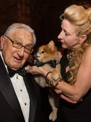 Franklin dog Swoosh, with mom Michelle Thompson, was presented the Animal Medical Center's Top Dog award in December in New York City by former secretary of state Henry Kissinger.