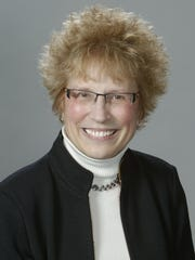 East Lansing school board President Nell Kuhnmuench