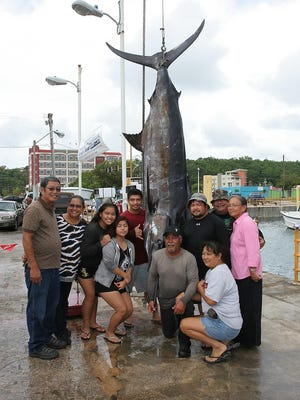 The crew of Gualafon brought in a 541.25-pound marlin to win the category at the 20th Annual Guam FishermenÕs Cooperative Association Guam Marianas International Fishing Derby on Sunday, Aug. 2, 2015.