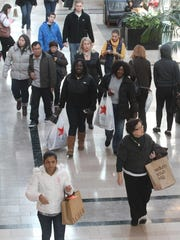 Shoppers take part in Black Friday shopping at the Bridgewater Commons mall.