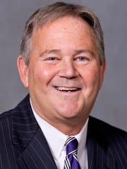 "In this undated photo provided by the Arkansas Secretary of State's office, Clark Mason poses for a photo. The Republican State Leadership Committee's Judicial Fairness Initiative has spent heavily on political ads for the chief justice race in Arkansas, but most of its attacks target Mason, a Little Rock lawyer seeking an open Supreme Court seat.  Thirty-second spots accuse Mason, who is opposed by Circuit Judge Shawn Womack, of charging high fees to his clients, dubbing him ""Clark 'Ka-Ching' Mason."""