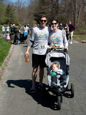 Hilary and Tyler Hughes and their son, Carter, at the first Star Legacy 5K in South Salem in 2015.  Hilary's first son, Oliver, was stillborn in 2013.
