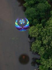 Pilot Daniel Reusch, flying Sub Divo, flys near a river