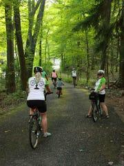 People ride along the trails at Tour de Zoo Thursday evening.