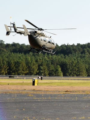Two Louisiana National Guard UH-72 Lakotas depart from Army Aviation Support Facility #2 at Esler Field in Pineville, Louisiana, for Hurricane Matthew response operations, Oct. 8, 2016.