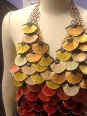 "Kathleen Nowak Tucci's ""Hummingbird Dress"" is made from reused multicolored Nespresso coffee capsules."
