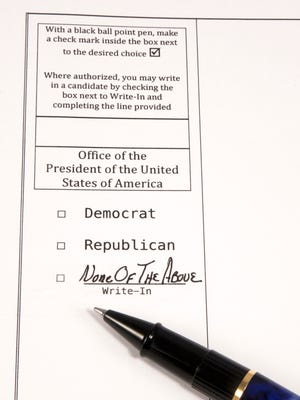 Ballot for voting for President of the United States of America with None of the Above filled on the line for Write-In