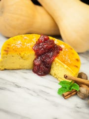 Butternut Cheesecake with Maple-Poached Cranberries is festive enough to move from Thanksgiving to Christmas.