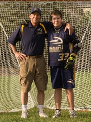 Evan Thompson, 13, with his father Eric, who coached