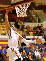 Midwestern State's Brandon Neel gets the steal and the dunk Thursday evening as the MSU Mustangs hosted the West Texas Buffaloes at D.L. Ligon Coliseum.