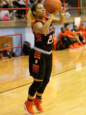 Paradize Jackson of the Burkburnett Lady Bulldogs shoots for three Friday night as the Hirschi Lady Huskies took on the Burkburnett Lady Bulldogs in 4A action.
