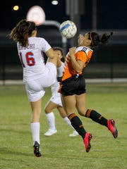 Hirschi's Sirena Juarez (16) and Burkburnett's Marley Cooke battle for the ball Tuesday evening as the Lady Huskies claimed a 5-1 win.