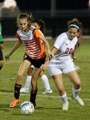 Burkburnett's Lauren Johnston dribbles past Hirschi's Lydia Acuna Tuesday night at the MSU soccer field.