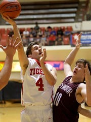 Richard Cleaver / Special for the Times Record News Electra Tiger Andrew Marsh attempts the basket Tuesday evening at MSU's DL Ligon Coliseum in playoff action.