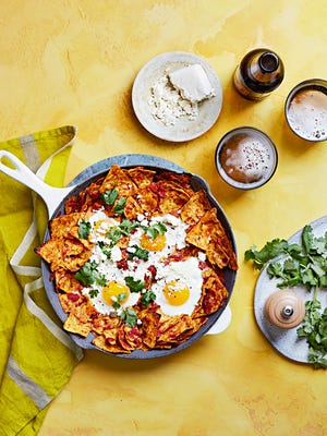 Talk about texture: The top chips in this take on chilaquiles stay crisp, while the bottom layer soaks up the sauce.