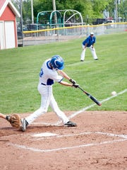 Harper Creek senior Jeremiah Davis gets a hit against Pennfield in the district semifinal on Saturday.