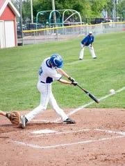 Harper Creek senior Jeremiah Davis gets a hit against