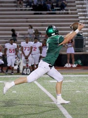 Iowa Park receiver Billy Pearson stretches out for the catch on continues for a touchdown Friday in Iowa Park against the Gainesville Leopards.