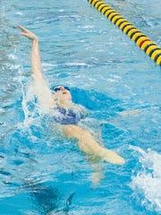 Harper Creek senior Jena Wager wins the 100 backstroke.