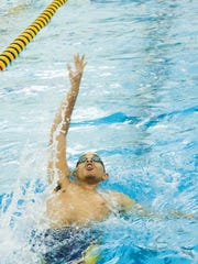 Battle Creek Central Sophomore, Brandon Cole, swims backstroke during the 400 Yard IM Relay Saturday afternoon