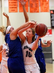Benjamin's Brooke Jones attempts the shot against Krum's