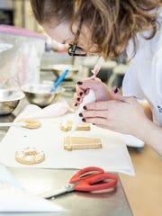 Katherine Hood decorates her sugar cookies.
