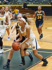 Battle Creek Central Freshman, Alliyah Caswell, drives