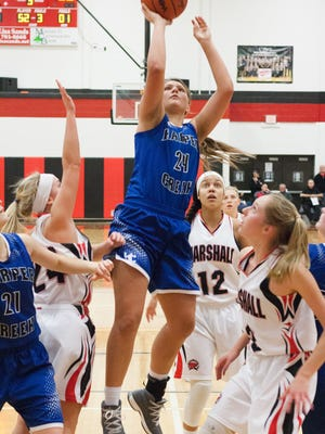 Harper Creek freshman Maddie Alexander goes up for a shot in the Beavers win over Marshall on  Friday.