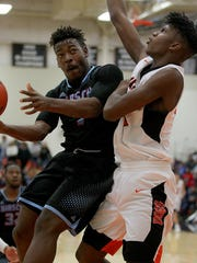 Hirschi's Daimarqua Foster goes up for the basket as