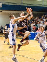 Marshall Junior, Jeremy Luciani, goes up for a basket