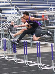 Tayvon Hughes competes in the 100-meter hurdles Friday evening for Lakeview.