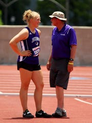 Jacksboros' Baylee Thompson discusses strategy with coach Joel Hood Friday at the state track meet.