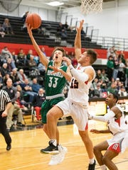 Luke Davis of Pennfield goes up for a layup against