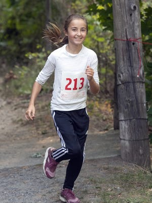 Samuel Fuller School student Olivia Redder runs in the school's 14th annual trail run October 10 at Pratt Farm in Middleboro.