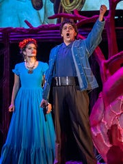 "Soprano Catalina Cuervo as Frida Kahlo and bass-baritone Ricardo Herrera in Robert Xavier Rodriguez's opera ""Frida,"" coproduced by Michigan Opera Theatre and Macomb Center for the Performing Arts."