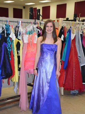 Faith Flynn, a freshman at Luxemburg-Casco High School, models a prom dress at the sale.