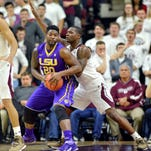 LSU's Brian Bridgewater (20) tries to get around Texas A&M's Jalen Jones (12) during a game Feb. 17 in College Station, Texas.